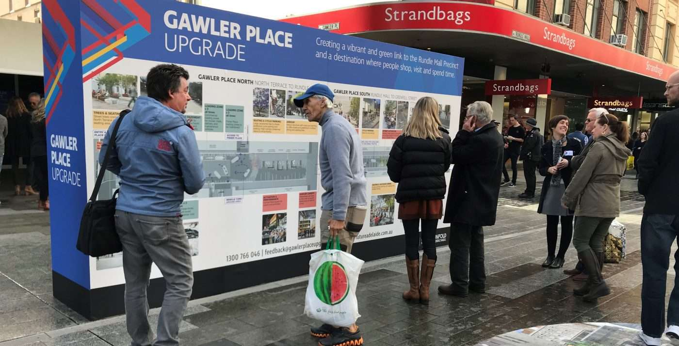 People looking at a way-finding information sing in Rundle Mall, Adelaide